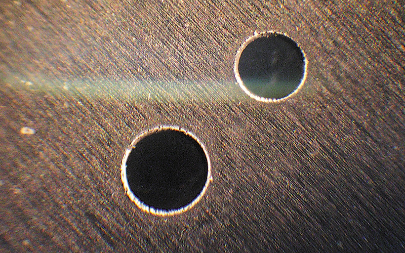 Holes cut by laser in tantalum (0.4 and 0.3 mm diameters)