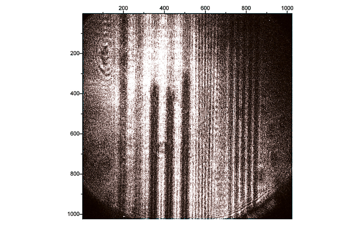 An image of ODT covered etched gold sample. The lines are spaced, in order left-right  20, 5, 2, and 8 micrometers. Image taken at ω<sub>IR</sub> = 2875 cm⁻¹ and acquired for 5000 laser shots.<br>
